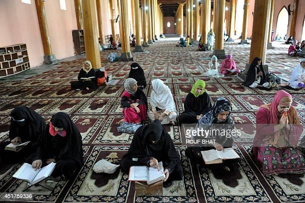Kashmiri Muslim women reads the Koran Islam's holy book during the holy month of Ramadan at Jamia Masjid in downtown Srinagar on July 6 2014 Across...