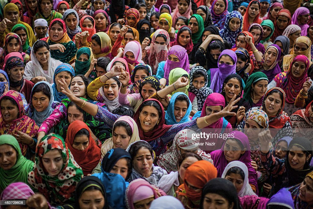 Kashmiri Muslim women shout anti Indian and pro Kashmir freedom slogans as they mourn during the funeral of Bilal Ahmad Bhat, 23, a civilian who was allegedly shot dead by Indian paramilitary Border Security Force (BSF) on August 12, 2015 in Larkipur, 35 km (21 miles) south of Srinagar, the summer capital of Indian administered Kashmir, India. Hundreds of Kashmiris participated in the funeral of Bhat who was killed by the Indian paramilitary BSF after they allegedly opened fire on the protestors who were protesting against the killing of two Lashkar-e-Taiba (Army of the Righteous), one of the largest and most active militant organization operating in Indian administered Kashmir, militants in an gun battle in Rakh-e-Lajura village of south Kashmir district on 11 August 2015.