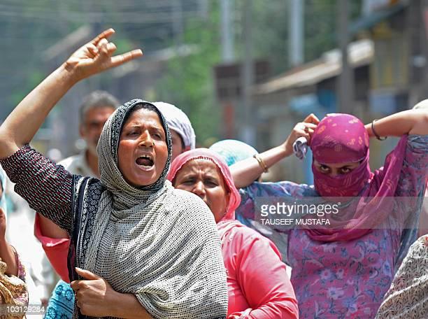 Kashmiri Muslim women shout anti-India slogans during a protest in Srinagar on July 26, 2010. The death of a man in police custody in...