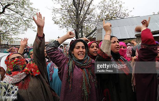 Kashmiri Muslim women shout pro freedom and anti India slogans during the funeral ceremony of Bilal Ahmad Bhat a militant of Hizbul Mujahideen outfit...