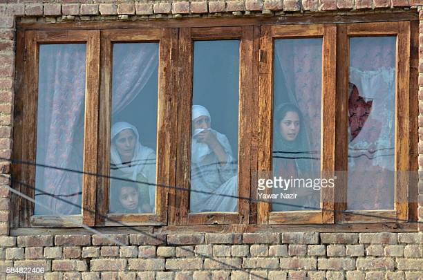 Kashmiri Muslim women watch protesters from the window of their house during an antiIndian and proKashmir freedom demonstration following violence...