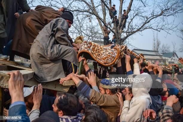 SHOPIAN JAMMU KASHMIR INDIA Kashmiri Muslims are seen carrying dead body of Khalid Farooq Malik during his funeral procession Malik was among the 6...