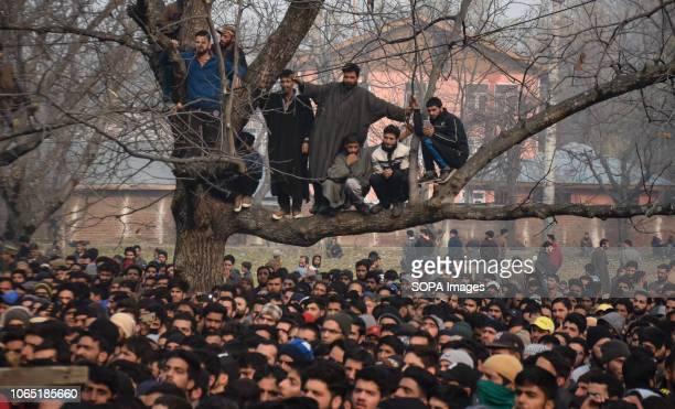 SHOPIAN JAMMU KASHMIR INDIA Kashmiri Muslims are seen watching the funeral procession of the Slain militant Khalid Farooq Malik Malik was among the 6...