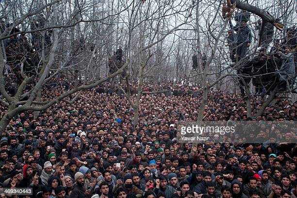Kashmiri Muslims attend the funeral of Arshid Ahmad , one of two Kashmir militants killed in a gun battle with Indian government forces, during his...