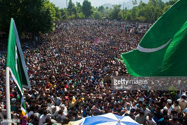 Kashmiri Muslims attend the funeral of Burhan Muzaffar Wani a top Hizbul Mujahideen commander killed in a brief gun battle with Indian government...
