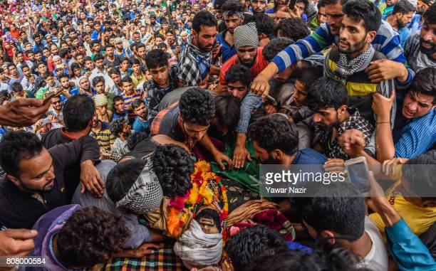Kashmiri Muslims attend the funeral of Jahangir Khanday a Kashmiri rebel killed in a gun battle with Indian government forces on July 4 2017 in...