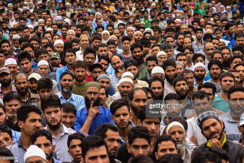 Kashmiri Muslims attend the funeral of Parvaiz Ahmad Mir, a local rebel killed in a gun battle with Indian government forces on July 16, 2017 in Pohoo, 26km (16miles) south of Srinagar, the summer capital of Indian administered Kashmir, India. Thousands of mourners in Kashmir joined the funeral of the three rebels who were killed in a gunfight with government forces on Saturday. The day long gun battle started on Saturday on a hillock where the militants were taking shelter in a cave in the forest area of the Tral region in south Kashmir's Pulwom district, and ended yesterday evening. Indian government forces then launched a cordon and search operation, the militants hiding in a cave up the hill opened fire at the forces which retaliated, triggering a gun battle. Of the three militants killed in the gun battle, two were locals and had recently joined the militant outfit, and the third was a Pakistani national. The militants killed are believed to be members of Pakistan-based Jaish-e-Mohammad (JeM) militant outfit.