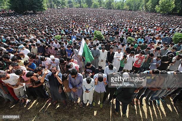 Kashmiri Muslims attend the funeral procession of top militant commander Burhan Muzaffar Wani in Shareef village in Tral some 40km south of Srinagar...