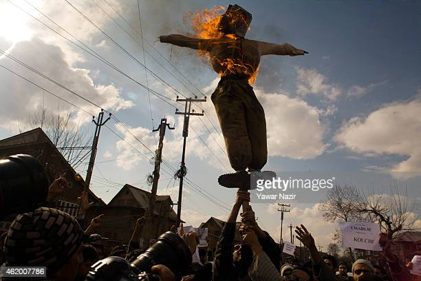 Kashmiri Muslims burn an effigy of Stephane Charbonnier the editor of Charlie Hebdo who was killed in the attacks in Paris during a protest against...