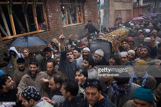 Kashmiri muslims carry a coffin containing the body of teenager Zahid Farooq to his burial place on February 06 2010 on the outskirts of Srinagar...