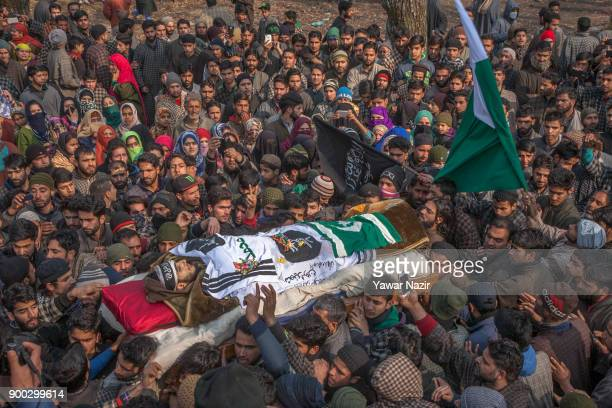 Kashmiri Muslims carry the body of 16 year old rebel Fardeen Ahmad Khandey killed after he carried out a suicide attack yesterday on Indian...