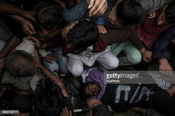 Kashmiri Muslims carry the body of Adil Ahmad a civilian who was crushed to death by an Indian forces' vehicle during his funeral procession Saturday...