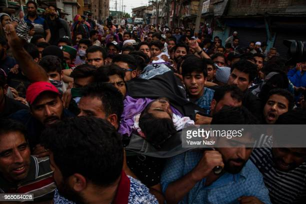 Kashmiri Muslims carry the body of Adil Ahmed Yadoo a civilian mown down by Indian police armored vehicle during his funeral procession on May 5 2018...