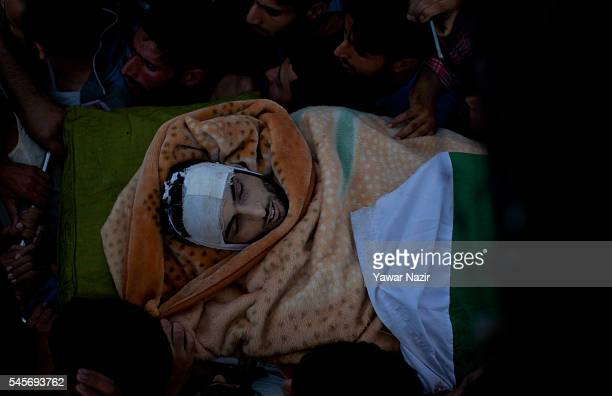 Kashmiri Muslims carry the body of Burhan Muzzafar Wani on July 9 2016 in Tral south of Srinagar the summer capital of Indian Administered Kashmir...