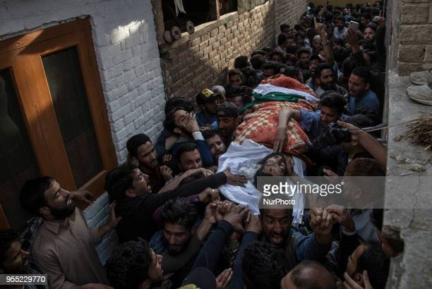 Kashmiri Muslims carry the body of Fayaz Ahmad Hamal a local rebel during his funeral procession Saturday May 5 in Srinagar Indiancontrolled Kashmir...