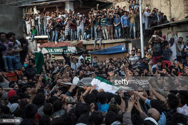Kashmiri Muslims carry the body of Fayaz Ahmad Hamal a local rebel during his funeral procession Saturday May 5 2018 in Srinagar Indiancontrolled...