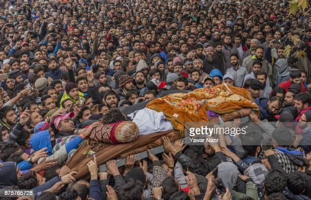 Kashmiri Muslims carry the body of Mugees Ahmad Mir a local rebel killed in a brief gun fight with Indian government forces during his funeral on...