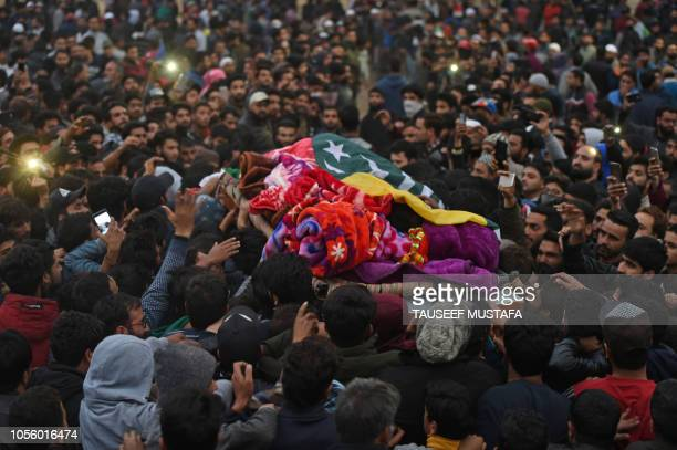 Kashmiri Muslims carry the body of slain militant Muhammed Amin Mir during his funeral procession at Pampore area of Polwama district south of...