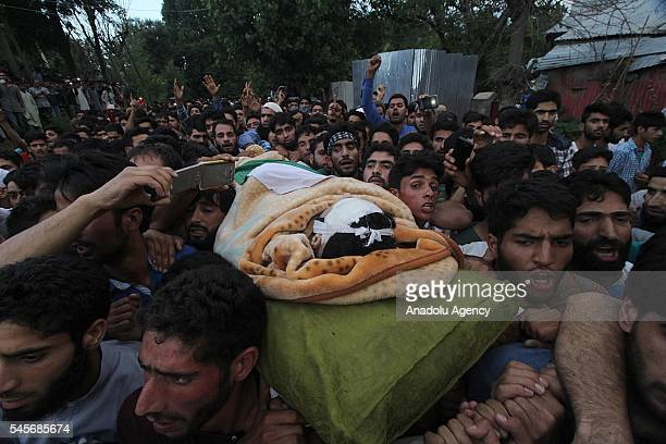 Kashmiri Muslims carry the dead body of Burhan Muzaffar Wani in Shareef village in Tral some 40km south of Srinagar the summer capital of Indian...