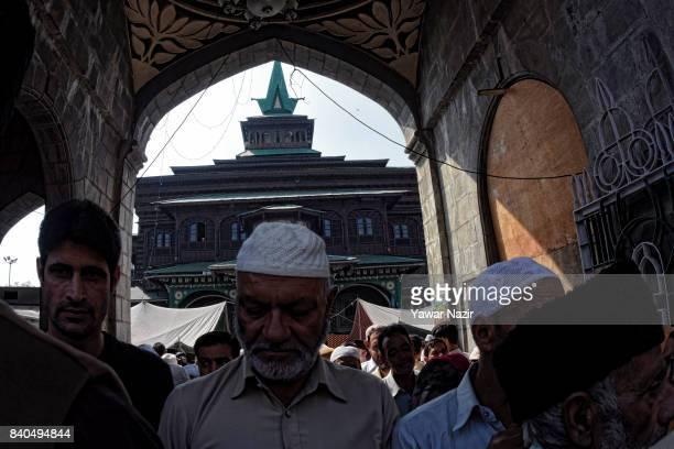 Kashmiri Muslims enter the shrine of Khaniqahi mullah during a festival on August 29 2017 in Srinagar the summer capital of Indian administered...