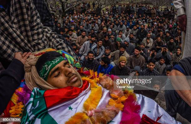 Kashmiri Muslims gather to attend the funeral ceremony of Amir Nazir a 15 year old teenager who was killed by Indian government forces during clashes...