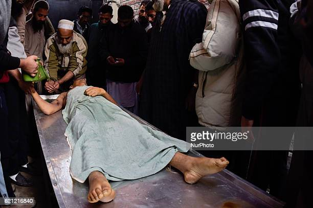 Kashmiri Muslims give customary bath to the body of Qaisar Sofi a 16 year old boy who succumbed to his injuries during his funeral on November 05...