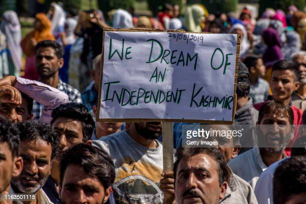 Kashmiri Muslims hold placards as they shout anti Indian slogans during an anti Indian protest, on August 23, 2019 in Srinagar, the summer capital of...