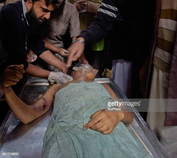 Kashmiri Muslims offer funeral prayers next to the body of Qaisar Sofi a 16 year old boy who succumbed to his injuries during his funeral on November...