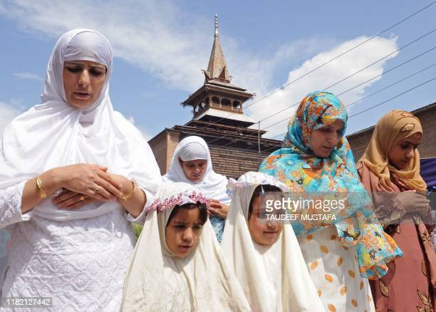 Kashmiri Muslims offer JummatUlVida the last Friday prayers ahead of the Eid alFitr festival during the month of Ramadan outside the historic Jamia...
