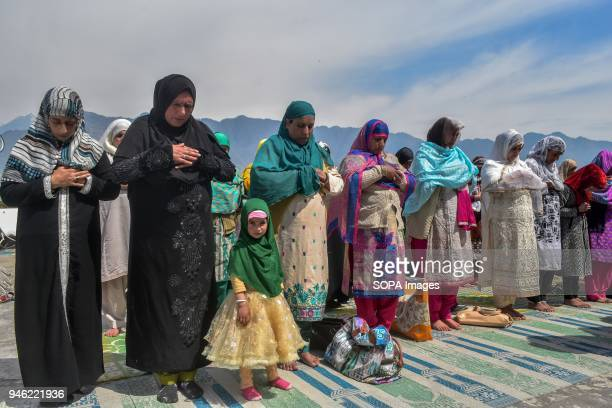Kashmiri Muslims offer noon prayers on the occasion of the Islamic festival ShabeMeraj at Hazratbal Shrine in Srinagar Indian administered Kashmir...