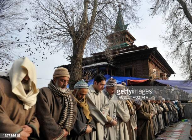 Kashmiri Muslims offer prayers at the shrine of Sufi saint Naqashband Sahib in downtown Srinagar on January 27, 2012. Thousands of People gathered to...