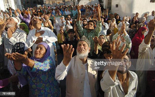 Kashmiri Muslims offer prayers on the Friday following 'ShabeMeraj' as the unseen head priest of the Hazratbal Shrine displays the holy relic...