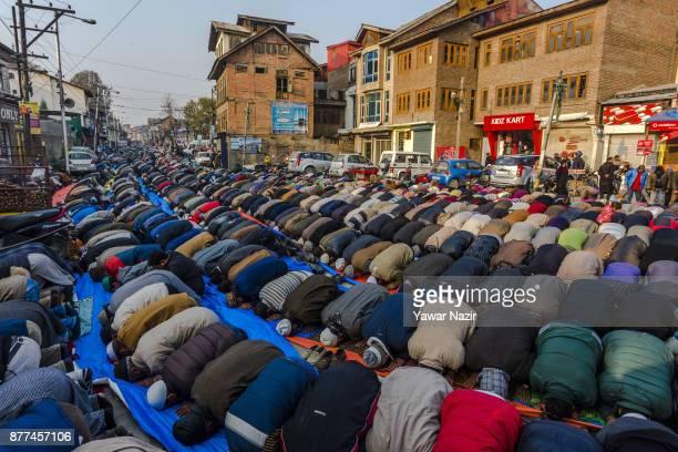 Kashmiri Muslims offer prayers outside the shrine of Khwaja Naqshband on November 22 2017 in Srinagar the summer capital of Indian administered...