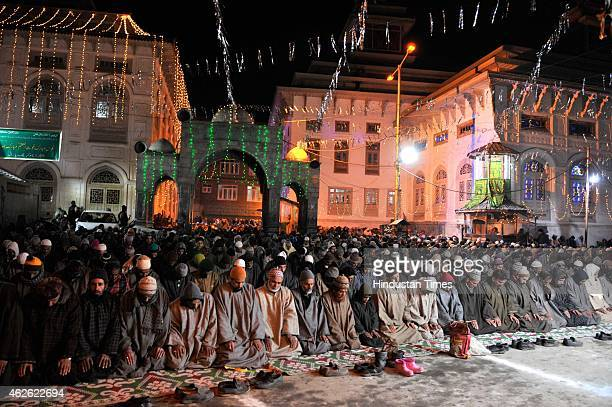 Kashmiri Muslims offer prayers outside the shrine of Sheikh Syed Abdul Qadir Jeelani on February 1 2015 in Srinagar India Hundreds of devotees...