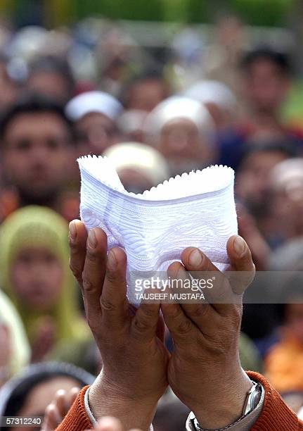 Kashmiri Muslims pray as a cleric unseen displays a relic of Prophet Mohammed to mark the birth anniversary of the Prophet at Hazratbal Shrine in...