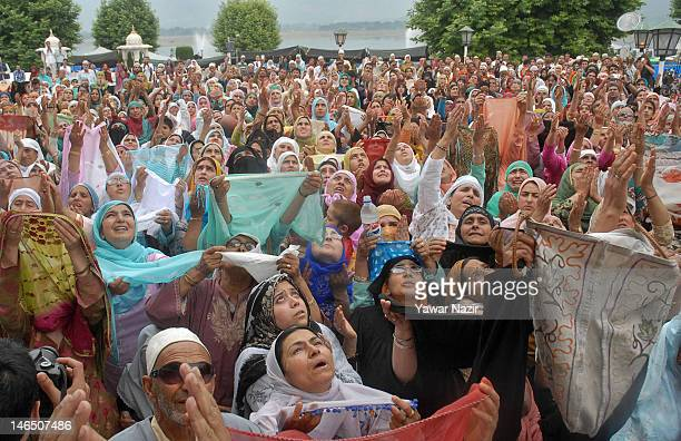 Kashmiri Muslims pray as a head priest displays the holy relic believed to be the hair from the beard of the Prophet Mohammed on the occasion of the...