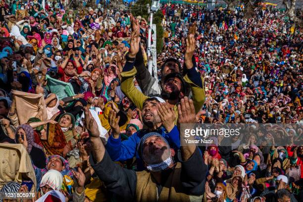Kashmiri Muslims pray as a Muslim cleric displays the holy relic believed to be the whisker from the beard of the Prophet Mohammed at the Hazratbal...