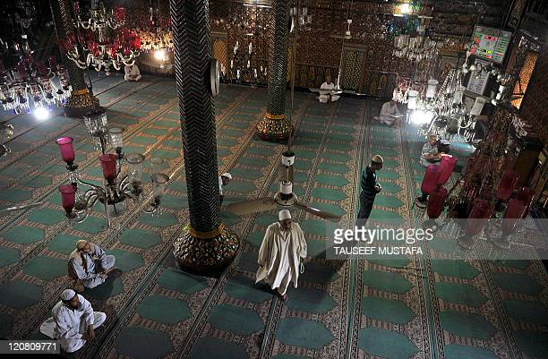 Kashmiri Muslims pray at the Shah-i-Hamdaan shrine during Ramadan in Srinagar on August 11, 2011. Islam's holy month of Ramadan is calculated on the...