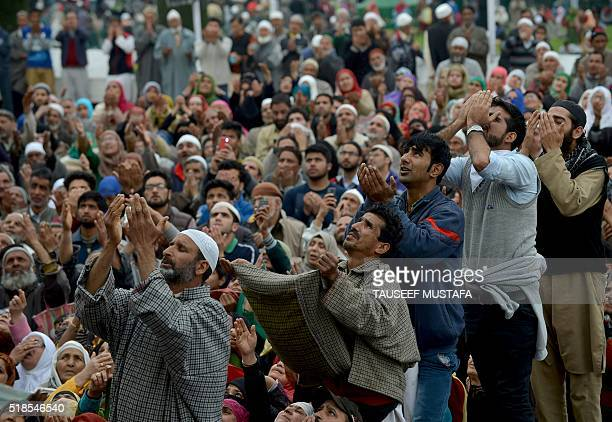Kashmiri Muslims react as a cleric shows a relic believed to be a hair from the beard of the Prophet Mohammed during special prayers on the death...