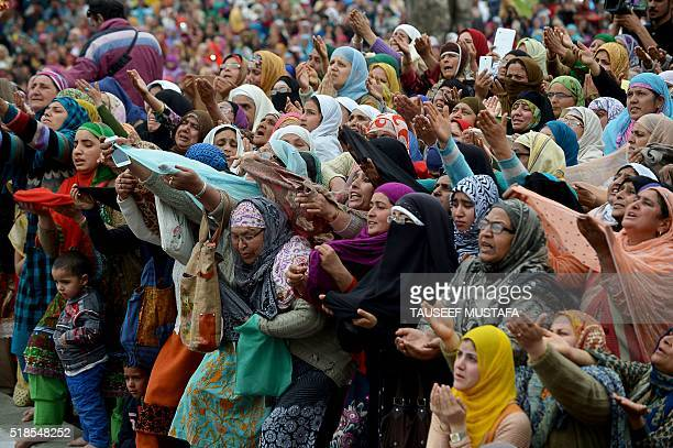 TOPSHOT Kashmiri Muslims react as a cleric shows a relic believed to be a hair from the beard of the Prophet Mohammed during special prayers on the...