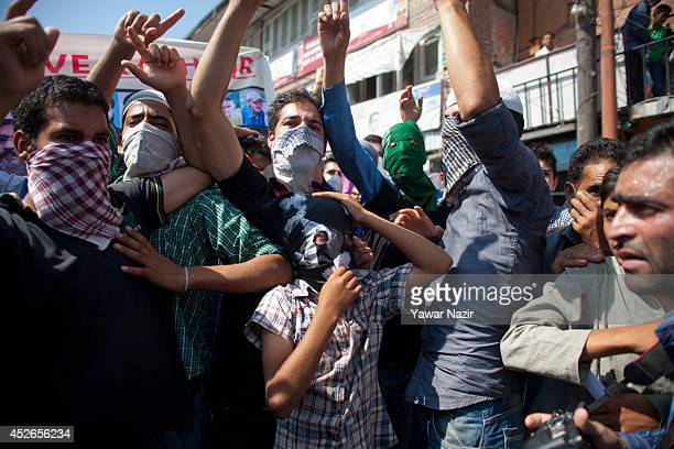 Kashmiri Muslims shout anti Israeli and pro Palestinian slogans during a protest against Israel after Friday prayers on the last Friday of the holy...