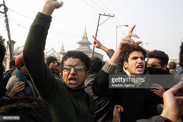 Kashmiri Muslims shout pro Pakistan slogans as a mark of solidarity with Peshawar victims killed in Taliban attack on a militaryrun school after an...