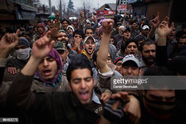 Kashmiri muslims shout slogans as they protest the death of teenager Zahid Farooq during his funeral procession on February 06 2010 on the outskirts...