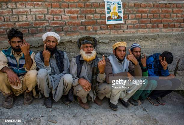 Kashmiri nomads show their indelible ink marked fingers after casting their votes during the third phase of Indian generalelection on April 23 in...