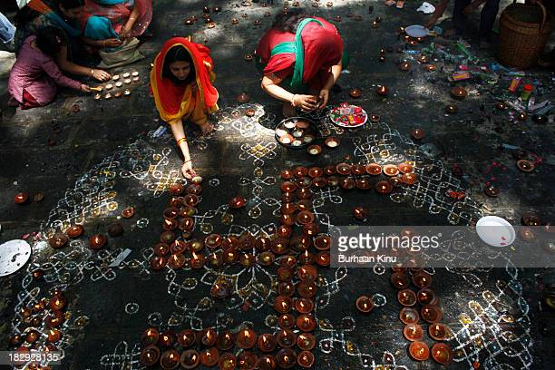 Kashmiri Pandit devotees pray during the annual Hindu festival at the Khirbhawani temple in Tullamulla village some 30 kms east of Srinagar the...