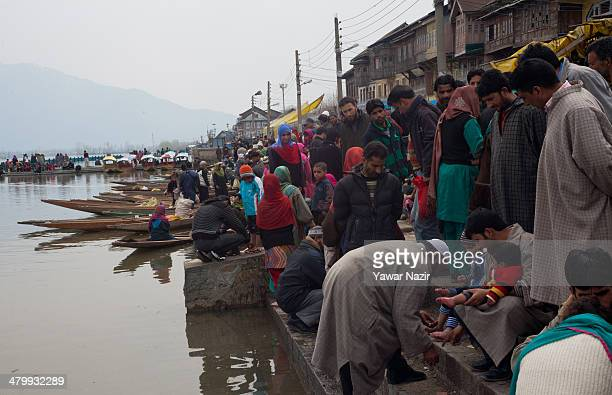 Kashmiri patients receive leech therapy from practitioners on the bank of Dal lake on March 21 in Srinagar the summer capital of Indian administered...