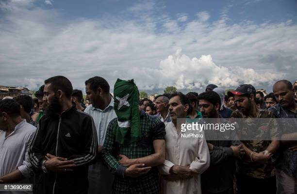 Kashmiri people offer funeral prayers to a local rebel Sajad Gilkar Wednesday July 12 2017 in Srinagar Indianadministered Kashmir India Government...