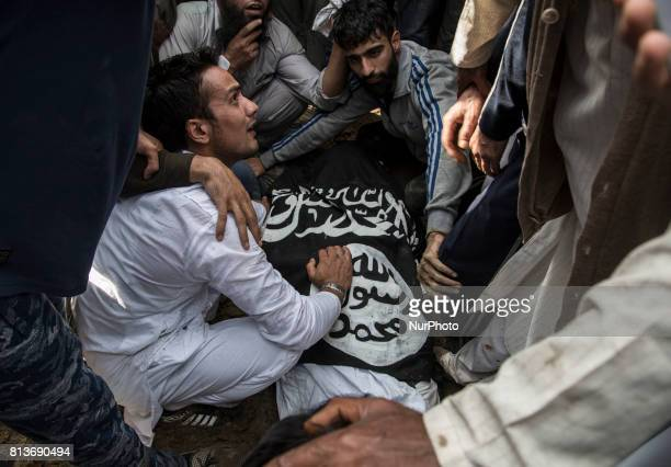 Kashmiri people touch the body of a local rebel Sajad Gilkar during during his funeral Wednesday July 12 2017 in Srinagar Indianadministered Kashmir...