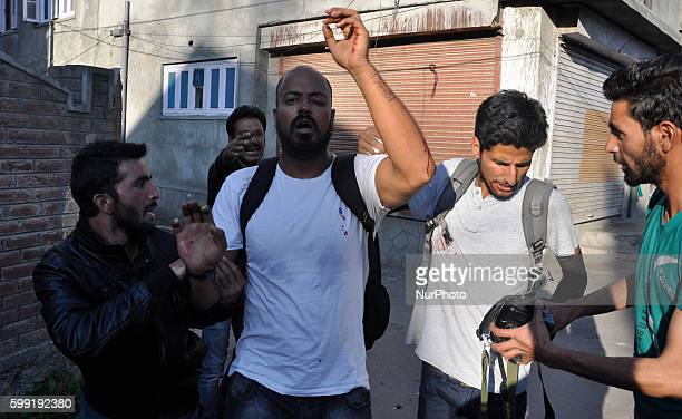 A kashmiri Photojournalist being Taken Away to hospital after he received Pellets fired by indian policeman in old city srinagar on september...