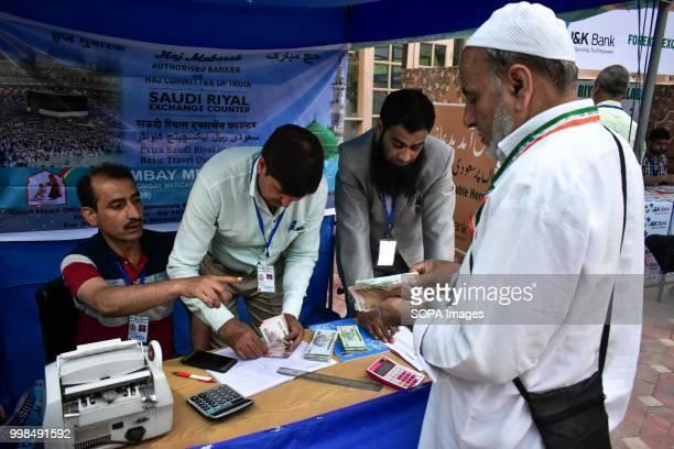 Kashmiri pilgrim exchange currency at hajj house in Srinagar Indian administered Kashmir The first batch of 820 Kashmiri pilgrims set off for the...
